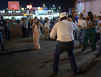 Several people of the cowboy culture dance popular Sonoran regional music in the esplanade of the band musical ensembles or also called Taka takas, during the first weekend of festivity or largest livestock popular fair in Sonora known as Expogan Sonora. Sunday 29 April 2019. (Photo: LuisGutierrez / NortePhoto)...<br />