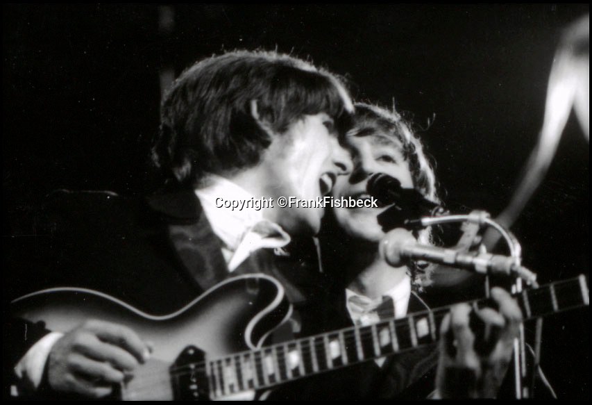BNPS.co.uk (01202 558833)<br /> Pic: FrankFischbeck/Spink/BNPS<br /> <br /> Lennon and Harrison on stage at the Circus Krone Bau in Munich - 2 months later they quit the stage for good.<br /> <br /> Unseen photos of the fab four touring Germany in 1966 are being sold showing the group just before they ditched the suits, gave up touring and embraced the flower power revolution.<br /> <br /> The candid snaps were taken by enterprising photographer Frank Fishbeck in Munich and Essen in June 1966 after he had managed to <br /> follow them into their Munich hotel and they invited him to their concert.