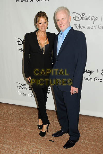 Nancy Lee Grahn, Anthony Geary.Disney ABC Television Group 2012 TCA Summer Press Tour Party held at the Beverly Hilton Hotel, Beverly Hills, California, USA, 27th July 2012..full length blue navy suit black  .CAP/ADM/BP.©Byron Purvis/AdMedia/Capital Pictures.