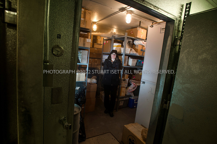 10/30/2012--Seattle, WA, USA..Stephanie Lamson, 44, a preservation librarian for the University of Washington Libraries, poses inside a freezer at the University's Burke Museum where newly arrived library books were frozen to kill bed begs...©2012 Stuart Isett. All rights reserved.