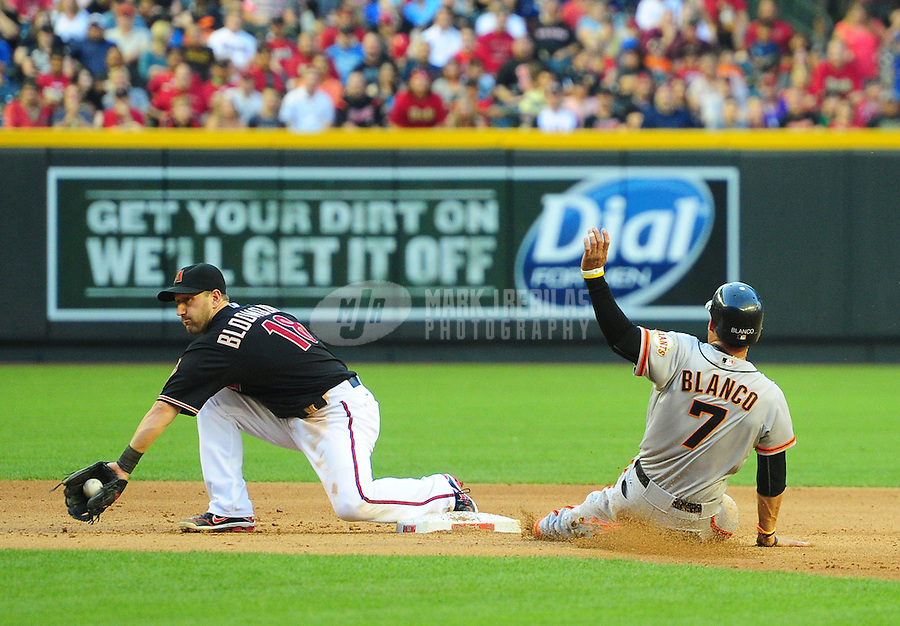 May 12, 2012; Phoenix, AZ, USA; San Francisco Giants base runner Gregor Blanco (7) slides safely into second base ahead of the tag by Arizona Diamondbacks infielder Willie Bloomquist in the first inning at Chase Field. Mandatory Credit: Mark J. Rebilas-