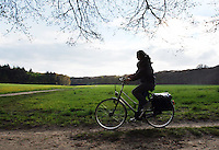 Girl running with bike in Netherlands