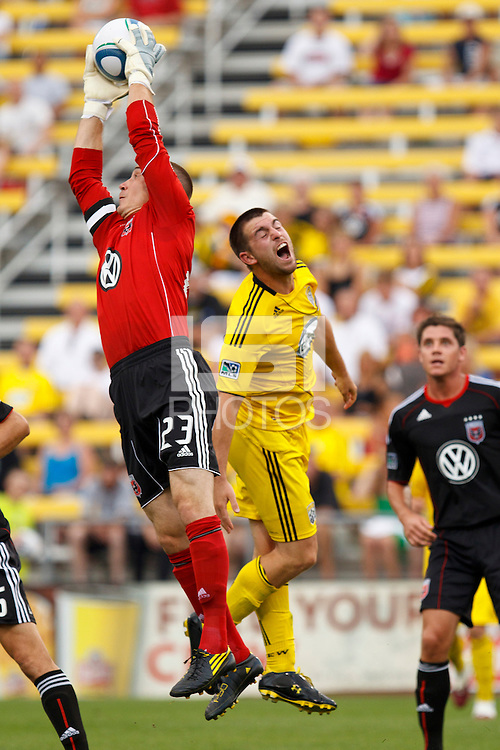 26 JUNE 2010:  Troy Perkins #23 of DC United  and Jason Garey of the Columbus Crew (9) during MLS soccer game between DC United vs Columbus Crew at Crew Stadium in Columbus, Ohio on May 29, 2010. The Crew defeated DC United 2-0.