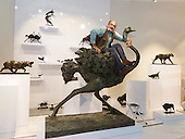 London, UK. 20 June 2015. Relieved that the sculpture got to the art fair in one piece, sculptor Mark Coreth poses on the life-size ostrich bronze at the stand of Sladmore Contemporary for the Masterpiece art fair. The sculpture weighs more than 500kg. Masterpiece London is a leading international cross-collecting fair for art, antiques and design. It takes place at The Royal Hospital Chelsea from 25 June – 1 July.