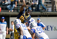 September 17, 2011:  California's Richard Rodgers jumps over  Presbyterian offensive linemen during a game at AT&T Park, San Francisco, Ca    California Defeated Presbyterian 63 - 12