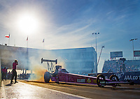 Oct 16, 2015; Ennis, TX, USA; NHRA top fuel driver Antron Brown does a burnout during qualifying for the Fall Nationals at the Texas Motorplex. Mandatory Credit: Mark J. Rebilas-USA TODAY Sports
