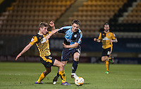 Ryan Ledson of Cambridge United fouls Stephen McGinn of Wycombe Wanderers during the Sky Bet League 2 match between Cambridge United and Wycombe Wanderers at the R Costings Abbey Stadium, Cambridge, England on 1 March 2016. Photo by Andy Rowland / PRiME Media Images.