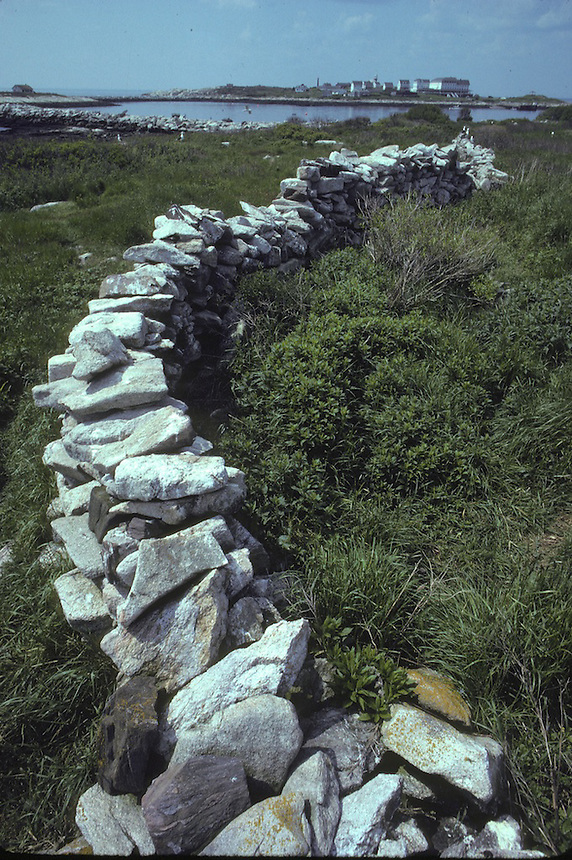 Ancient stonewall on Smuttynose Island, Isles of Shoals, Maine. Star Island in the background. Photograph by Peter E. Randall
