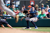 Atlanta Braves first baseman Johan Camargo (17) waits to receive a pick off throw as Dustin Peterson (13) dives back towards the base during a Grapefruit League Spring Training game against the Detroit Tigers on March 2, 2019 at Publix Field at Joker Marchant Stadium in Lakeland, Florida.  Tigers defeated the Braves 7-4.  (Mike Janes/Four Seam Images)