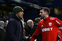 Gareth McAuley of West Brom nips into the crowd pre-match to speak with fellow Northern Ireland International and Charlton Athletic striker, Josh McGennis during Chelsea vs West Bromwich Albion, Premier League Football at Stamford Bridge on 12th February 2018