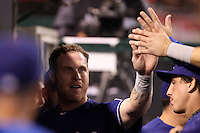 Texas Rangers center fielder Josh Hamilton #32 is greeted by his teammates during a game against the Los Angeles Angels at Angel Stadium on September 27, 2011 in Anaheim,California. Texas defeated Los Angeles 10-3.(Larry Goren/Four Seam Images)