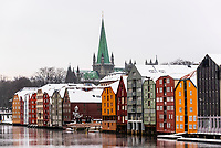 Former warehouses converted to apartments along the Nidelva River (with the Nidaros Cathedral in the background), Trondheim, Norway.