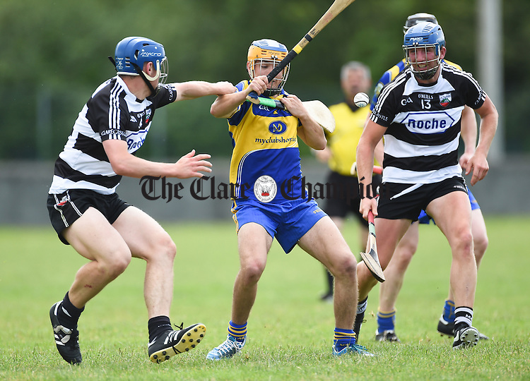 Padraig Mc Mahon of Newmarket in action against Mark Mc Guane and Patrick Tuohy of Clarecastle during their Clare Champion Cup game in Clarecastle. Photograph by John Kelly.