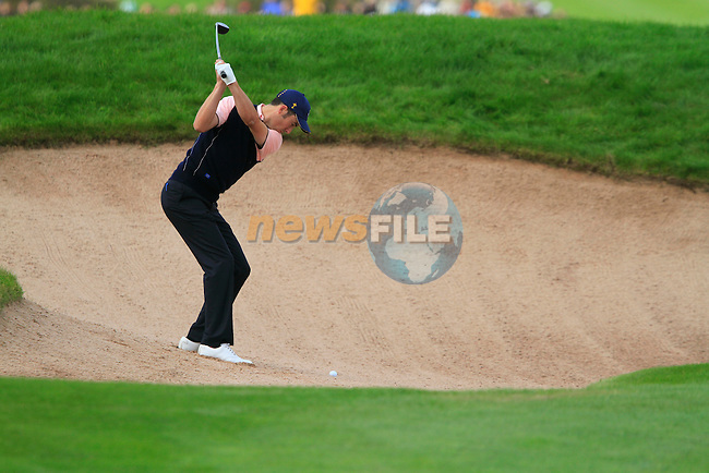 Ross Fisher plays out of a fairway bunker on the 16th hole during Practice Day 3 of the The 2010 Ryder Cup at the Celtic Manor, Newport, Wales, 29th September 2010..(Picture Eoin Clarke/www.golffile.ie)