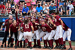 OKLAHOMA CITY, OK - JUNE 04: Anna Shelnutt #13 of the Florida State Seminoles and her teammates celebrate her home run against the Washington Huskies during the Division I Women's Softball Championship held at USA Softball Hall of Fame Stadium - OGE Energy Field on June 4, 2018 in Oklahoma City, Oklahoma. (Photo by Tim Nwachukwu/NCAA Photos via Getty Images)