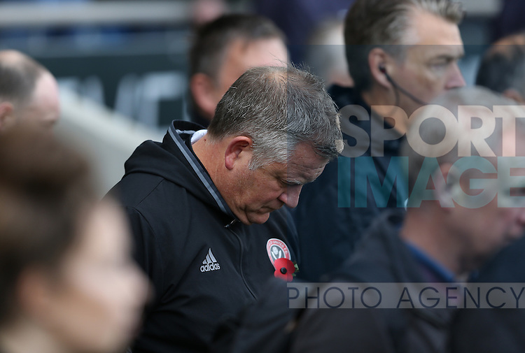 Chris Wilder manager of Sheffield Utd during the minutes silence during the English League One match at the Proact Stadium, Chesterfield. Picture date: November 13th, 2016. Pic Simon Bellis/Sportimage