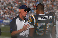 Sept. 17, 2006; San Diego, CA, USA; San Diego Chargers head coach Marty Schottenheimer talks with linebacker (56) Shawne Merriman against the Tennessee Titans at Qualcomm Stadium in San Diego, CA. Mandatory Credit: Mark J. Rebilas