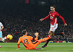 Adrian of West Ham United studs up on Zlatan Ibrahimovic of Manchester United as he scores during the English League Cup Quarter Final match at Old Trafford  Stadium, Manchester. Picture date: November 30th, 2016. Pic Simon Bellis/Sportimage