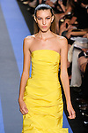 Kate walks runway in a cadmium yellow faille strapless draped trumpet gown, by Monique Lhuillier, from the Monique Lhuillier Spring 2012 collection fashion show, during Mercedes-Benz Fashion Week Spring 2012.