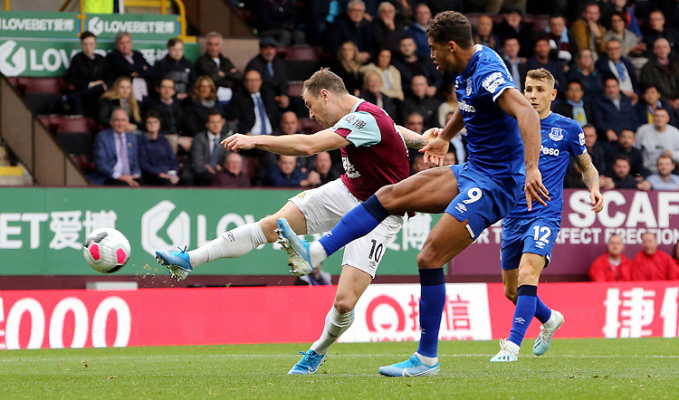 Burnley's Ashley Barnes shoots despite the attentions of Everton's Dominic Calvert-Lewin<br /> <br /> Photographer Rich Linley/CameraSport<br /> <br /> The Premier League - Burnley v Everton - Saturday 5th October 2019 - Turf Moor - Burnley<br /> <br /> World Copyright © 2019 CameraSport. All rights reserved. 43 Linden Ave. Countesthorpe. Leicester. England. LE8 5PG - Tel: +44 (0) 116 277 4147 - admin@camerasport.com - www.camerasport.com