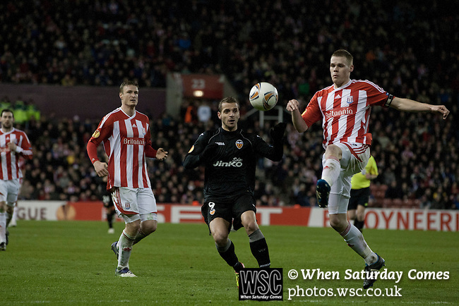 Stoke City 0 Valencia 1, 16/02/2012. Britannia Stadium, UEFA Europa League. Home defender and captain Ryan Shawcross making a clearance at the Britannia Stadium, Stoke-on-Trent, during the UEFA Europa League last 32 first leg between Stoke City and visitors Valencia. The match ended in a 1-0 victory from the visitors from Spain. Mehmet Topal scored the only goal in the first half in a match watched by a crowd of 24,185. Photo by Colin McPherson.