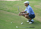 United States President Barack Obama lines up his shot on the 9th green as he enjoys a round of golf with Marvin Nicholson, Bobby Titcomb and Eric Whitaker at Mid Pacific Country Club, Kailua, Hawaii, on December 23, 2013.  The first family is enjoying holiday vacation in Hawaii until January 5, 2014.<br /> Credit: Cory Lum / Pool via CNP