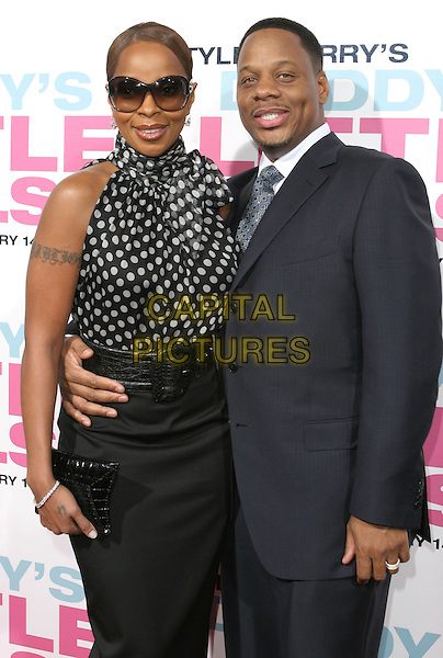"MARY J. BLIGE & KENDU ISAACS.""Daddy's Little Girls"" Los Angeles Premiere held at the Cinerama Dome, Hollywood, California, USA..February 7th, 2007.half length blue suit jacket arm around waist skirt sunglasses shades tattoo black white polka dot top.CAP/ADM/CH.©Charles Harris/AdMedia/Capital Pictures"