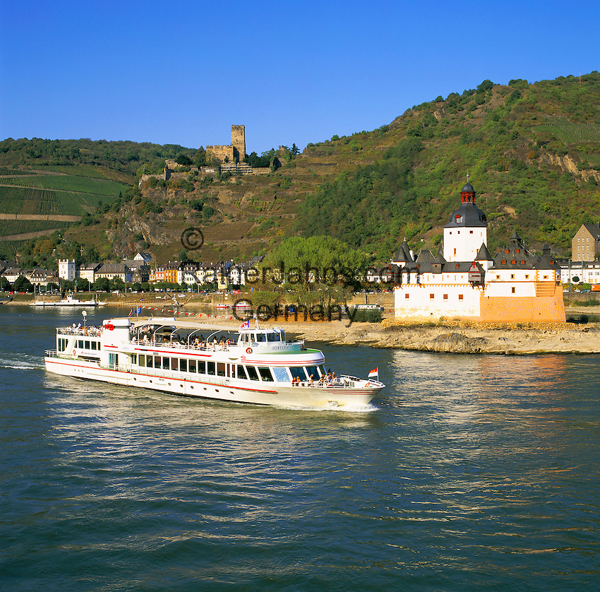 Germany, Rhineland-Palatinate, Kaub: River Rhine Cruise passing Fortress Pfalzgrafenstein and town Kaub with castle Gutenfels, The Rhine Gorge is a popular name for the Upper Middle Rhine Valley, a 65 km section of the River Rhine between Koblenz and Bingen in Germany. It was added to the UNESCO list of World Heritage Sites in 2002 | Deutschland, Rheinland-Pfalz, Kaub: Ausflugsschiff passiert die im Rhein gelegene Burg Pfalzgrafenstein und die oberhalb gelegene Burg Gutenfels, UNESCO-Welterbe Oberes Mittelrheintal