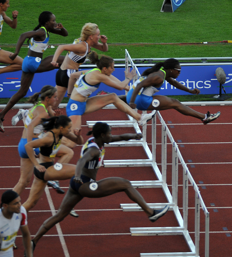 Photo: Tony Oudot/Richard Lane Photography. .Aviva London Grand Prix, Crystal Palace. 25/07/2008. .Kelly Sotherton (5) of Great Britain struggles with a misplaced hurdle during the womens 100m hurdle race as part of the Four Event Challenge.