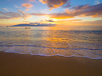 A beautiful Hawaiian sunset over Lana'i, as viewed from sandy Ka'anapali Beach, Maui.