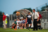 Sky Blue FC head coach Jim Gabarra greets forward Monica Ocampo (8) as she is subbed out of the game. Sky Blue FC defeated the Washington Spirit 1-0 during a National Women's Soccer League (NWSL) match at Yurcak Field in Piscataway, NJ, on July 6, 2013.