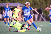Allston, MA - Sunday, April 24, 2016: Seattle Reign FC midfielder Jessica Fishlock (10) and Boston Breakers midfielder Kristie Mewis (19). The Boston Breakers play Seattle Reign during a regular season NSWL match at Jordan Field, Harvard University.