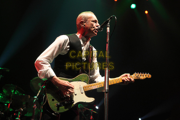Status Quo - Francis Rossi .performing live in concert, Moscow, Russia, 15th April 2010..music gig on stage half length white shirt guitar playing black waistcoat microphone singing .CAP/PER/SB.©SB/PersonaStars/Capital Pictures.