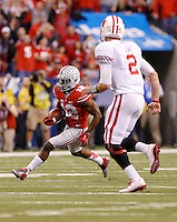 Ohio State Buckeyes cornerback Doran Grant (12) returns a pass he picked off from Wisconsin Badgers quarterback Joel Stave (2) during the third quarter of the Big Ten Championship game at Lucas Oil Stadium in Indianapolis on Dec. 6, 2014. (Adam Cairns / The Columbus Dispatch)
