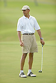 United States President Barack Obama reacts to his missed putt on the 18th hole at the Mid Pacific Country Club in Lanikai, Hawaii on January 1, 2014.<br /> Credit: Cory Lum / Pool via CNP