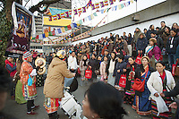 "Switzerland. Basel. St. Jakobshalle. A crowd of men and women, all tibetan, celebrate the visit of His Holiness the Dalai Lama. They sing and danse together outside in the cold winter afternon. The 14th and current Dalai Lama is Tenzin Gyatso, recognized since 1950. He is the current Dalai Lama, as well as the longest-lived incumbent, well known for his lifelong advocacy for Tibetans inside and outside Tibet. Dalai Lamas are amongst the head monks of the Gelug school, the newest of the schools of Tibetan Buddhism. The Dalai Lama, also called "" Ocean of Wisdom"" is considered as the incarnation of Chenresi, the Bodhisattva of compassion who is also the protective deity of Tibet. The Tibetan flag, also known as the ""snow lion flag"" and the 'Free Tibet flag', was a flag of the military of Tibet, introduced by the 13th Dalai Lama in 1912 and used for the same capacity until 1959. Designed with the help of a Japanese priest, it reflects the design motif of the Japanese military's Rising Sun Flag. Since the 1960s, it is used a symbol of the Tibetan independence movement. 7.02.2015 © 2015 Didier Ruef"