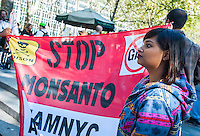 Activists gather in Bryant Park and march in New York on Saturday, October 12, 2013 during a worldwide protest against the Monsanto company and genetically modified food. The activists contend that genetically modified foods can lead to serious health problems including cancer and reduce the nutritional content of food. Genetically modified soy and grains make up almost 100 percent of the market notably because of the success of Monsanto's Round-Up Ready seeds and herbicides. (© Richard B. Levine)