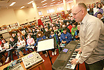 David Leddy with students from Scoil Aonghusa and St. Peters NS at the Jazz Workshop in Drogheda Library...Photo NEWSFILE/Jenny Matthews.(Photo credit should read Jenny Matthews/NEWSFILE)....This Picture has been sent you under the condtions enclosed by:.Newsfile Ltd..The Studio,.Millmount Abbey,.Drogheda,.Co Meath..Ireland..Tel: +353(0)41-9871240.Fax: +353(0)41-9871260.GSM: +353(0)86-2500958.email: pictures@newsfile.ie.www.newsfile.ie.FTP: 193.120.102.198.