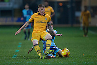 Paris Cowan-Hall of Wycombe Wanderers tackles Scot Bennett of Newport County during the Sky Bet League 2 match between Newport County and Wycombe Wanderers at Rodney Parade, Newport, Wales on 22 November 2016. Photo by Mark  Hawkins.