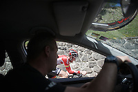 Tim Wellens (BEL/Lotto-Soudal) flashes by the team car and is getting cheers from soigneur Raoul Saren (BEL) who is following teammate Lars Bak (who he's about to catch) <br /> <br /> stage 15 (iTT): Castelrotto-Alpe di Siusi 10.8km<br /> 99th Giro d'Italia 2016