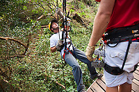 Man repelling with proper gear preparing to go Ziplining on the Big island with Kohala zipline