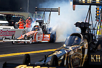 Oct 4, 2013; Mohnton, PA, USA; NHRA top fuel dragster driver Clay Millican (left) does a burnout alongside Khalid Albalooshi during qualifying for the Auto Plus Nationals at Maple Grove Raceway. Mandatory Credit: Mark J. Rebilas-
