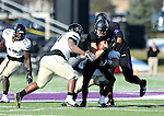 SIOUX FALLS, SD, NOVEMBER 26:  Luke Papillion #15 from the University of Sioux Falls is sacked for a loss by a pair of defenders including Tremaine Brock #98 from Harding University Saturday afternoon at Bob Young Field in Sioux Falls. (Photo by Dave Eggen/Inertia)