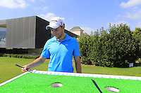 Max Kieffer (GER) tries the chopsticks challenge during Tuesday's Pro-Am Day of the 2014 BMW Masters held at Lake Malaren, Shanghai, China 28th October 2014.<br /> Picture: Eoin Clarke www.golffile.ie