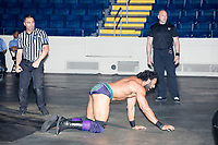 WWE Champion Jinder Mahal crawls on the floor after being attacked outside the ring during his match against Randy Orton at a WWE Live Summerslam Heatwave Tour event at the MassMutual Center in Springfield, Massachusetts, USA, on Mon., Aug. 14, 2017. Mahal lost the match.