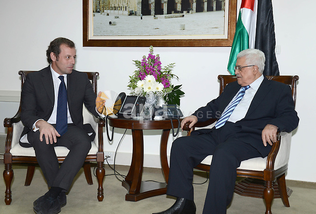 Palestinian President Mahmoud Abbas meets with FC Barcelona manager in the West Bank city of Ramallah on February 22, 2013. Photo by Thaer Ganaim