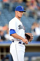Tulsa Drillers pitcher Brandon Erbe (39) during the ceremonial first pitch before a game against the Midland RockHounds on May 31, 2014 at ONEOK Field in Tulsa, Oklahoma.  Tulsa defeated Midland 5-3.  (Mike Janes/Four Seam Images)