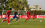 Players of Shabab Rafah football club compete with players of Hebron's Ahly al-Khalil football club in the first leg of the Palestine Cup final at the Yarmouk Stadium in Gaza City on August 1, 2017. Photo by Ashraf Amra