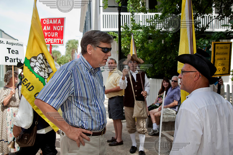 Rev Bob Setzer of Knollwood Baptist Church, Winston-Salem, North Carolina (in sunglasses).debates with members of the Tea Party while visiting St Augustine, Florida. 'With most fellow Americans, you and I can have a conversation and disagree. But these people.just want to shout you down. When they call the President a communist, they are being factually untrue and disrespectful. A communist doesn't believe in private property. President Obama believes in private property. He has property of his own. Jesus loved all people and I do as.well. Basically what I really object to is the fact that they disrespect the President and they misrepresent him. It doesn't serve civil democracy at all. Voices like theirs are divisive. They shout down anyone who disagrees. Jesus never had any vocal objection to homosexuals or to.liberals. The people he objected to were the obnoxious, self-righteous Pharisees. Those were the people Jesus tangled with, not the homosexuals or the liberals or even the communists. They are misrepresenting what a lot of people in our country believe. They should read their.bibles. Romans Chapter 13: 'respect the governing authority'. That means be respectful of the governing authority. They show no respect when they call my President a communist. That's a clear violation of scripture.' This local chapter of the Tea Party has fallen out with the Republicans who want to tone down their rhetoric. The Tea Party members have refused to be co-opted and brought into the Republican fold although they say they will still vote for Romney, to prevent the 'communist' Obama from being re-elected. They also believe Obama is doing the work o