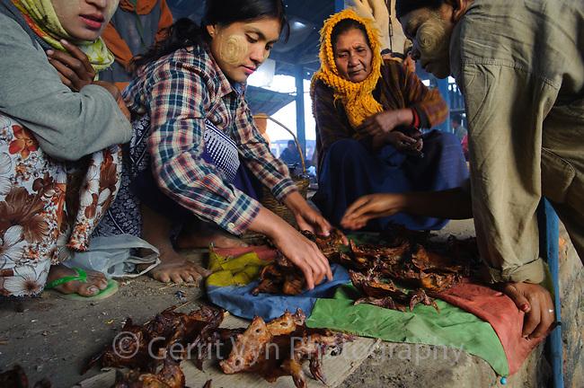 Women looking at rat meat in market at Mrauk-U. Rakhine State, Myanmar.